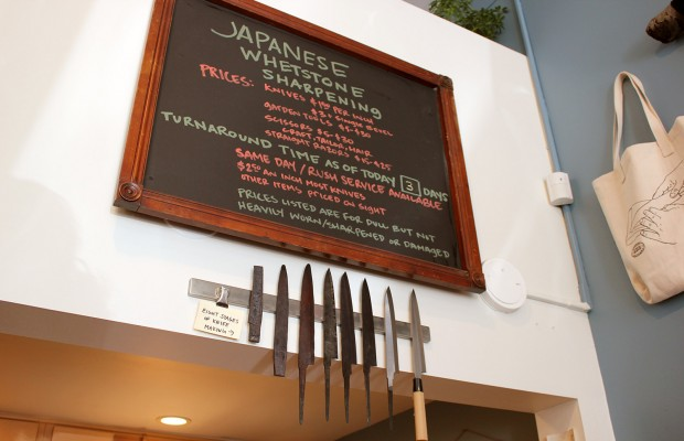 Inside Bernal Cutlery, a display shows the eight stages of knife sharpening.