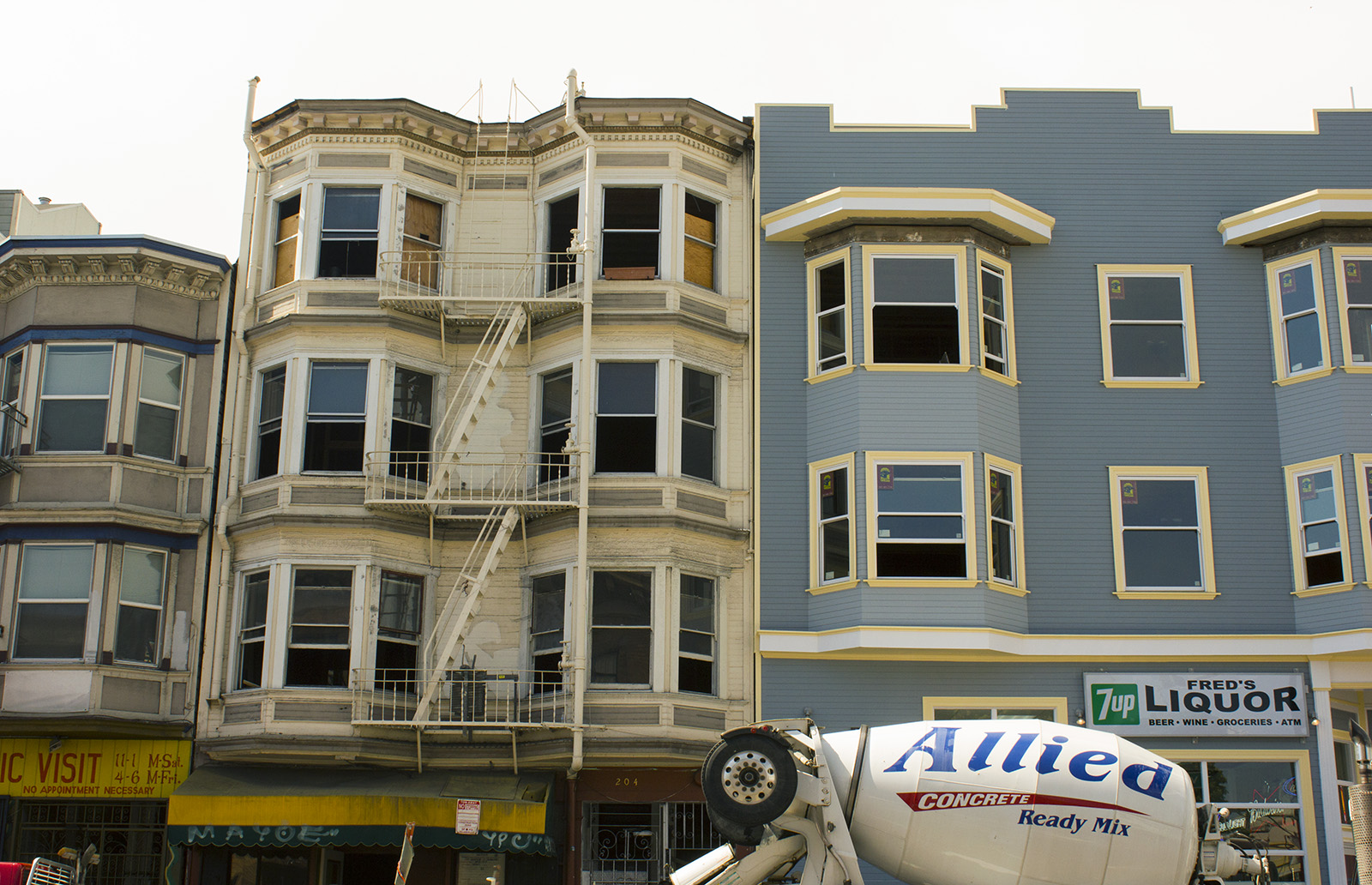 Some former tenants from the Valencia building (the beige building at left) are facing legal battles with the building's corporate owners, JJJ. Photo by Sarah McClure