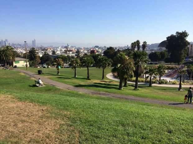 Picture of Dolores Park with view of city in background.