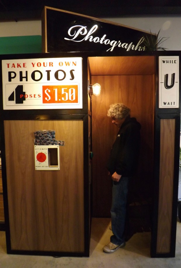 A shopper at Valencia Street's Dijital Fix checks out the old-school photo booth. Photo by Greta Mart.