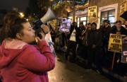 Protesters gather outside Mission Police Station to speak out against the events of last Friday at Valencia Gardens, when four men were arrested. Photo by Lynne Shallcross