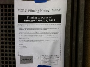 Filming notice posted along 21st and Harrison. Photo by Andrea Valencia.