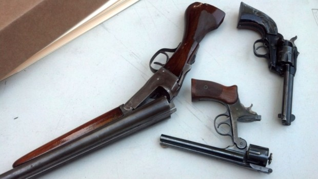 Guns given up at gun buyback night in August 2013. Photo by Molly Oleson.