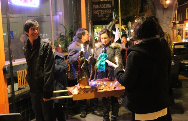 Las Posadas procession waits outside Pig&Pie to be let in.