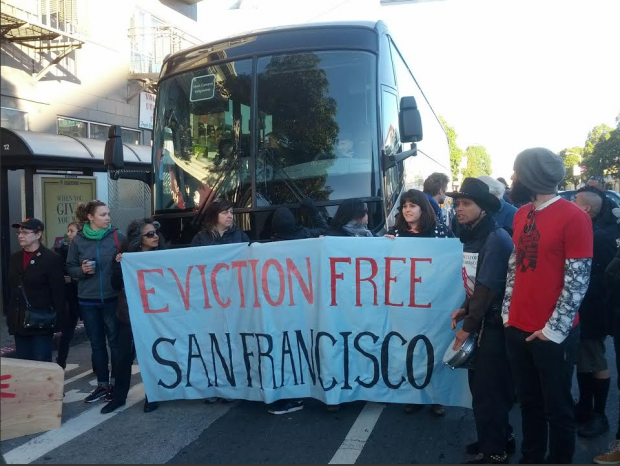 Protesters in front of an Apple bus on December 20. Photo by Dan Hirsch