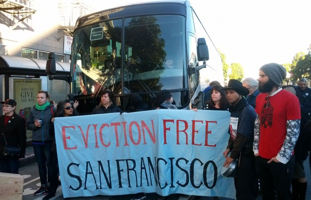 Protesters in front of Apple bus on December 20.