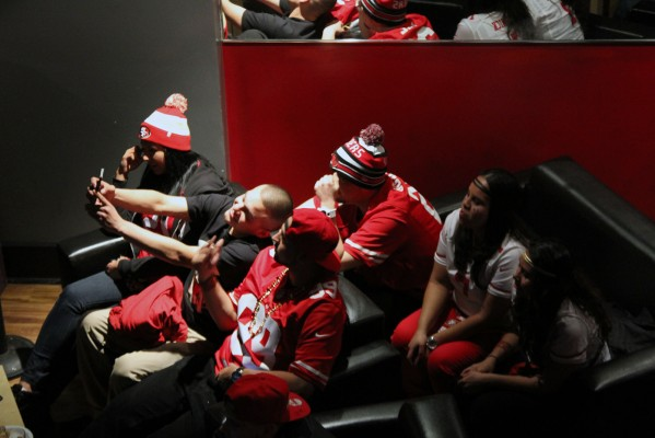 49ers fans wear red and white to support their team.