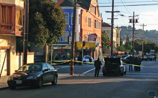 Officers respond to a two-car collision on 21st Street and South Van Ness Avenue. Photo by George Lipp.