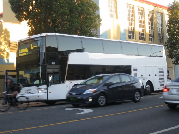 A tech bus rides down Valencia Street. Photo by Lydia Chávez.