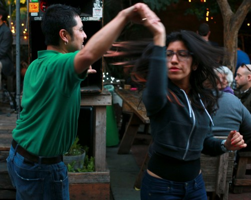 A couple twirls at a benefit for Christina Olague.