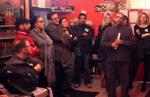 Carlos Gonzalez (right) speaks to the participants of Engage SF's first public dinner. Photo by Daniel Hirsch.