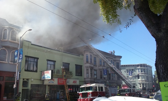 Initially the fire appeared to involve just the building on the corner of Mission and 29th. Photo by Anita O'Brien
