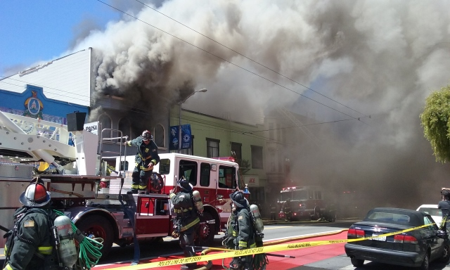 The fire quickly spread to Cole's Hardware, a neighborhood staple