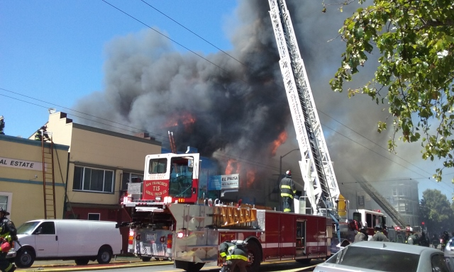 At least 5 hoses forced water into the burning buildings. Photo by Anita O'Brien