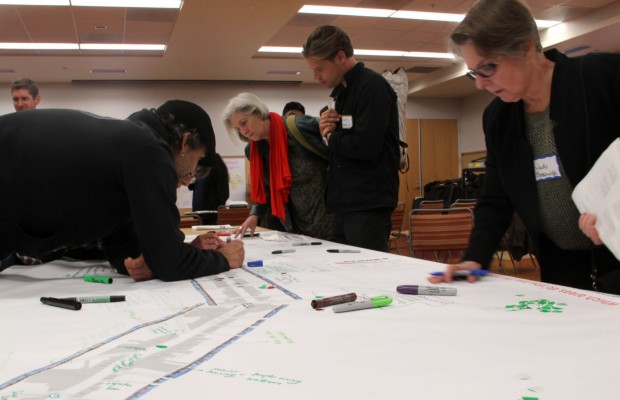 Community members at the Planning Department open house for Mission Street Life Plan annotate a map of Mission Street. Photo by Daniel Hirsch.