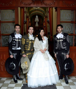 Diana Campos stands with her three brothers (who dressed up as charros, or Mexican cowboys) at her quinceañera in Mexico. Photo courtesy of Diana Campos.
