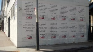 "A wall plastered with ""You're On"" Diet Coke ads on Stevenson Street."