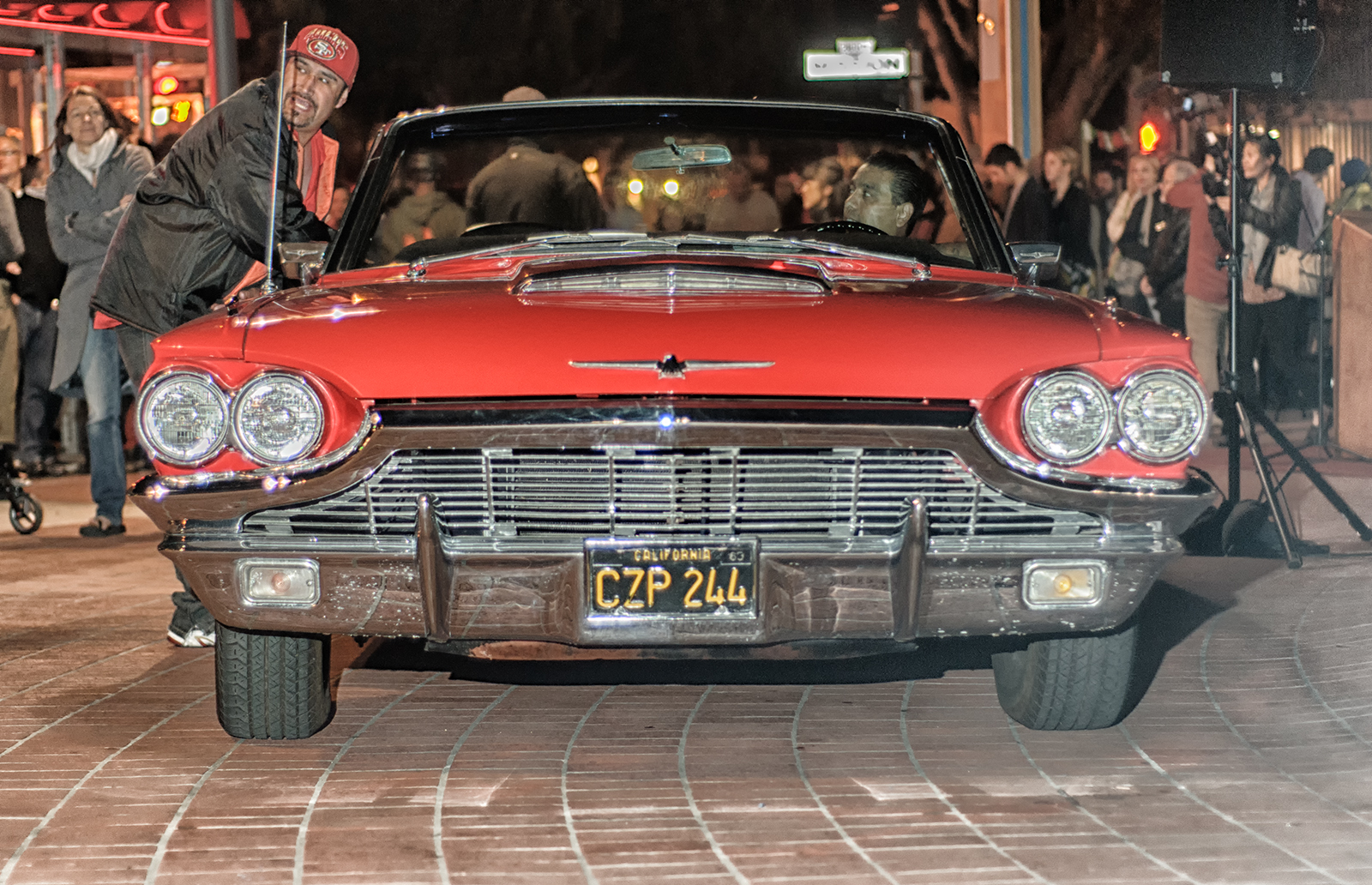 Dancer Humphrey Maleka arrives at the performance in a red, 1960s Thunderbird that drives onto the Plaza right up to the BART entrance.