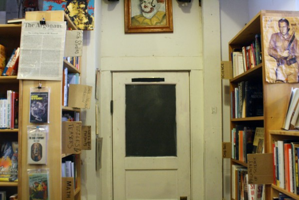 A mysterious door among many books in Alley Cat Books.