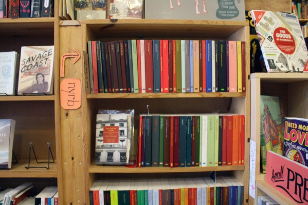 Close-up of the diverse colored books in Alley Cat Books.