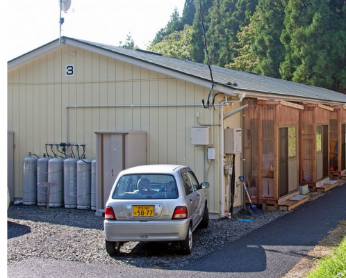 Temporary housing provided by the Japanese government. Behind each window lives a family.