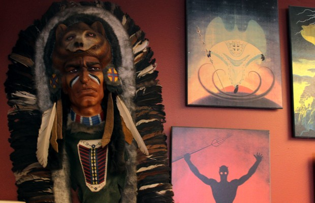 Spiritual artwork on the wall at Botanica Yoruba. Photo by Daniel Hirsch.