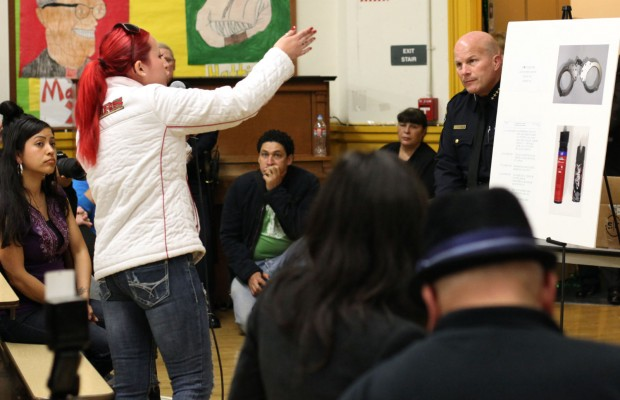 Woman directs anger at Chief of Police Greg Suhr (right) at community meeting.