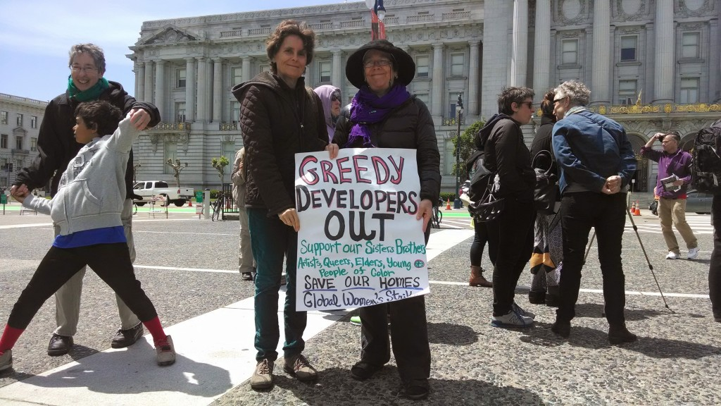 Lori Nairne and Rachel West, voluneers at Global Women's Strike.