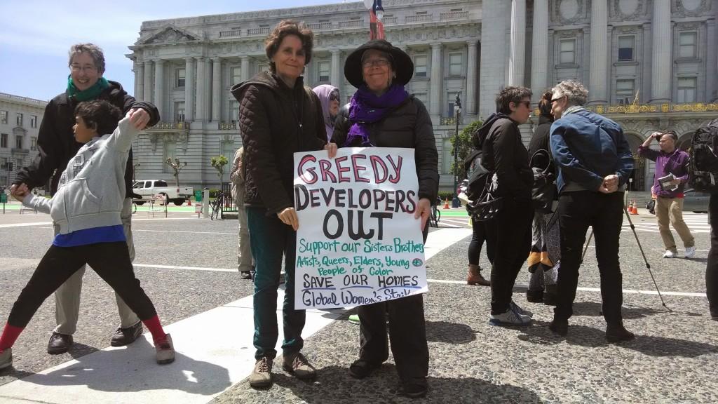 Lori Nairne and Rachel West, voluneers at Global Women's Strike.