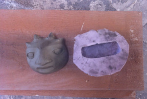 One of the many silicon molds and a bini face in the making.
