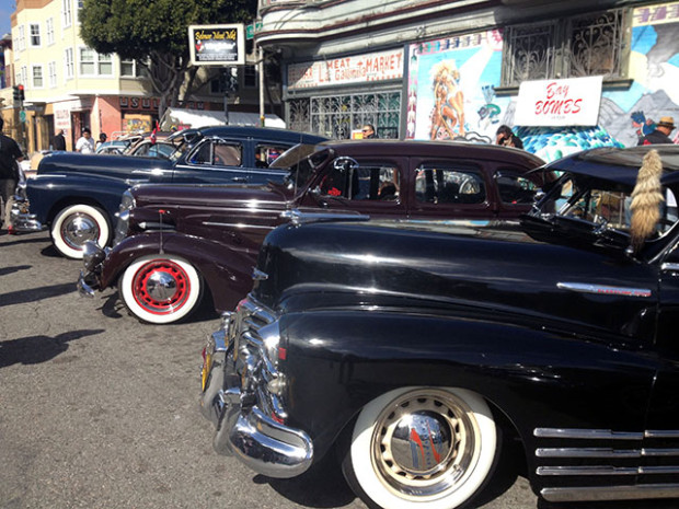 More than a dozen cars  parked on Harrrison after the parade.