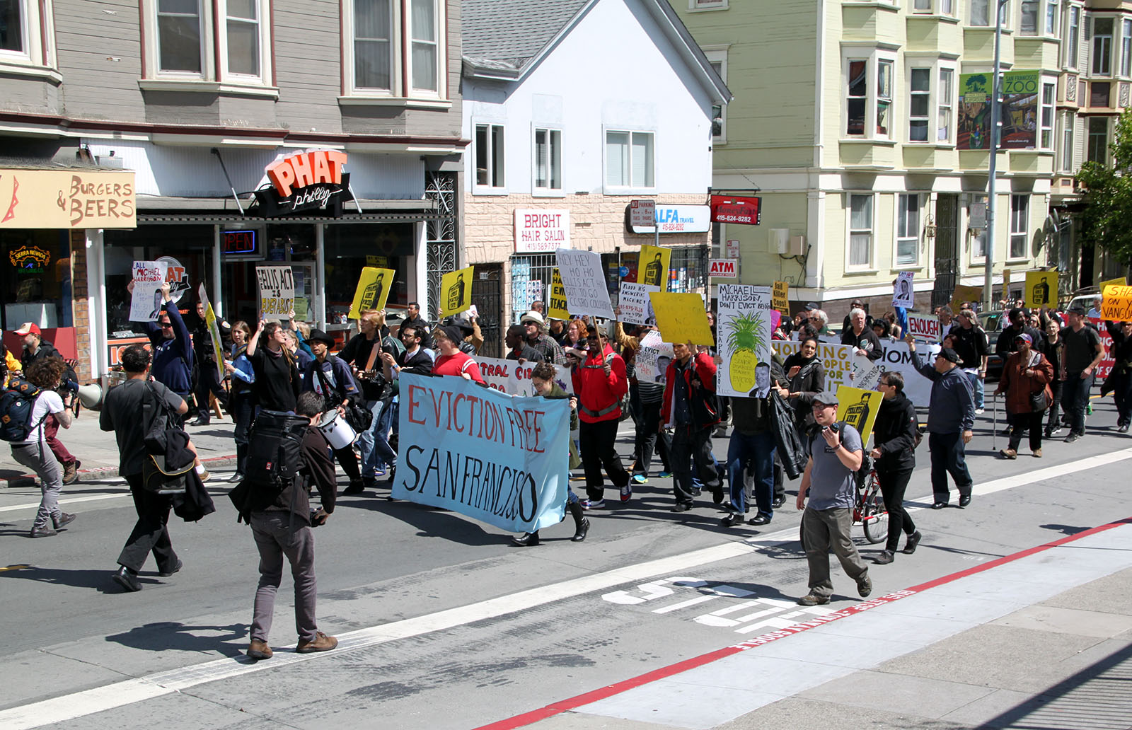 Demonstrators march on 24th Street to protest the eviction of Benito Santiago.