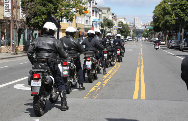Police officers on motorcycles ride during the anti-evtion protest.
