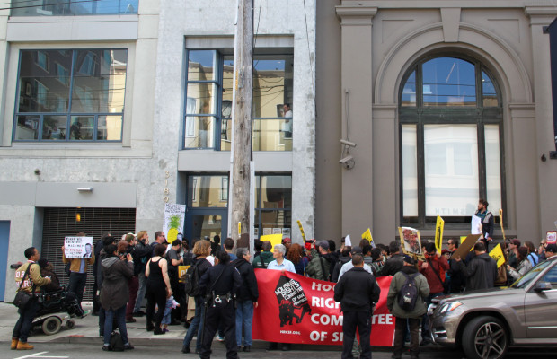 The marchers gathered at the 21st Street entrance of Vanguard Properties.