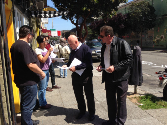 Thomas Rapp hands out flyers outside Dattani's office. Photo by Guadalupe González