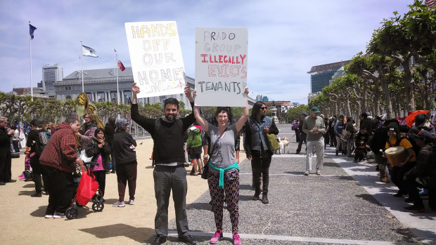 Mario Landau-Holdsworth and Liz Pettit protest their eviction. Photo by Erica Hellerstein.