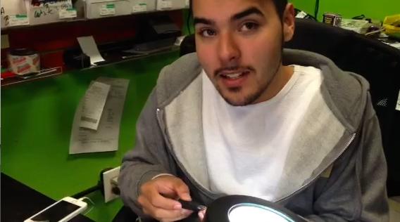 Santiago Bliss busy fixing iPhones
