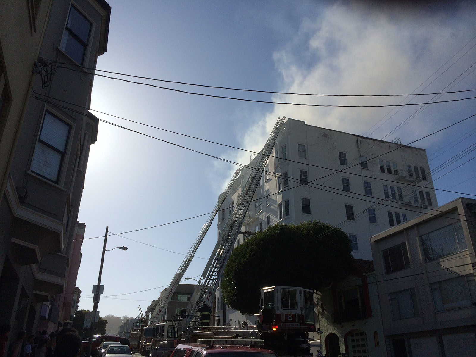 Firefighters have placed ladders on the side of the building on 14th and Dolores. Photo by Mark Rabine.
