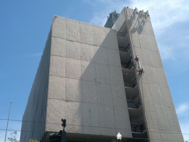 Workers rappelling down US Bank Building.