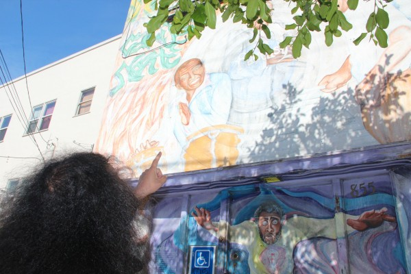 Dogpaw points to mural for Fantasy Records on its former building on Treat street. Photo by Viktorija Rinkevičiūtė.