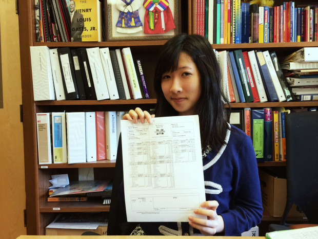 Michelle Nguyen holds her transcript proudly. Photo by Andra Cernavskis