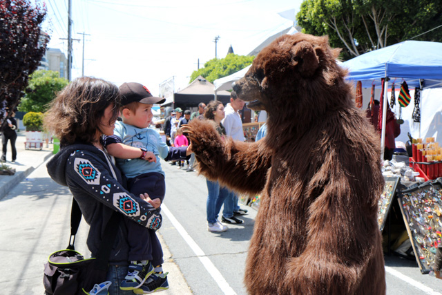 The Bear is working the crowd. Photo by Claire Weissbluth