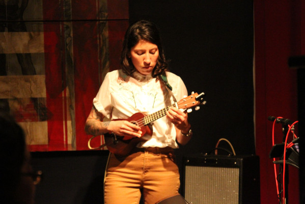 Carolyn Cardoza playing her ukelele. Photo by Jasmine Koerber