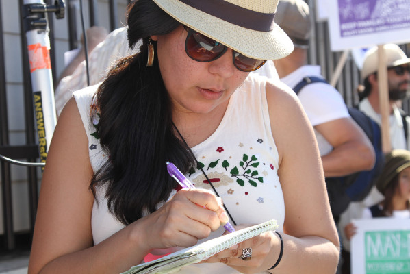 """Coralia Solis, 32, volunteer at the Balance Coalition and MC at this event and leading people to the chant of, """"Who does the Mission belong to? To us!"""" """"I grew up in El Salvador during the war and my parents have always been involved in social issues,"""" she said. """"The community is losing its basic..."""