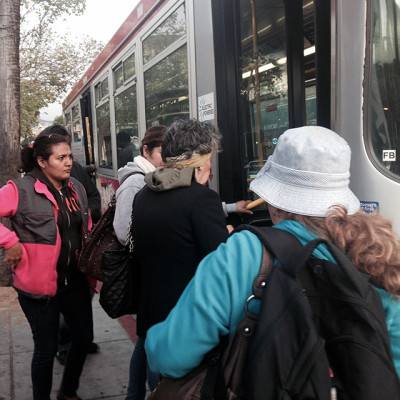 Riders boarding on 24th headed West. Photo by Lydia Chávez