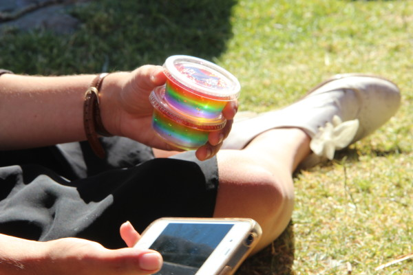 """Rainbow jello shots were sold two for five dollars at Saturday's Dyke March. """"We stayed up all night making them,"""" said Lupe Thun with her friend Alisha Dickson. Photo by Leslie Nguyen-Okwu"""