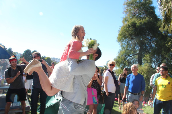 A new bride is lifted by her husband after getting married at Saturday's Dyke March. Photo by Leslie Nguyen-Okwu