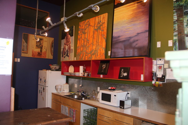 A kitchenette completes the homey atmosphere of the gallery. Photo by Joe Rivano Barros.