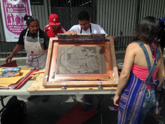 The Bay Area chapter of YoSoy 132 --labeled as Mexico's Occupy movement, made posters for passerby's.