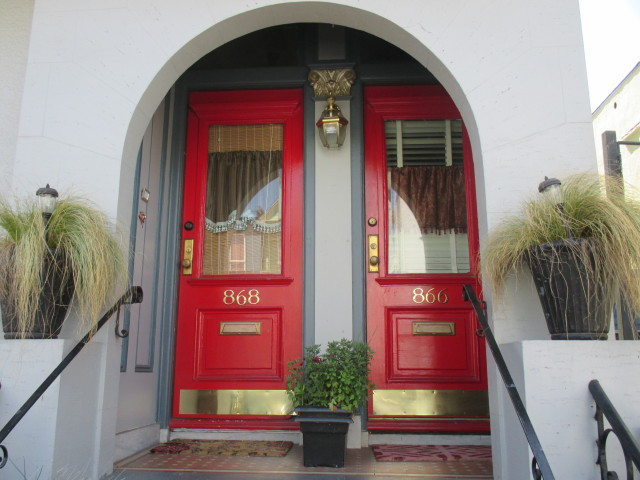 In Front of the Reddest Doors